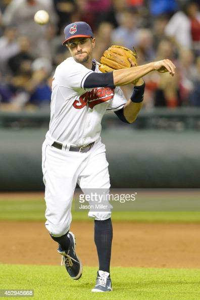 Third baseman Lonnie Chisenhall of the Cleveland Indians throws out James Jones of the Seattle Mariners at first during the ninth inning at...