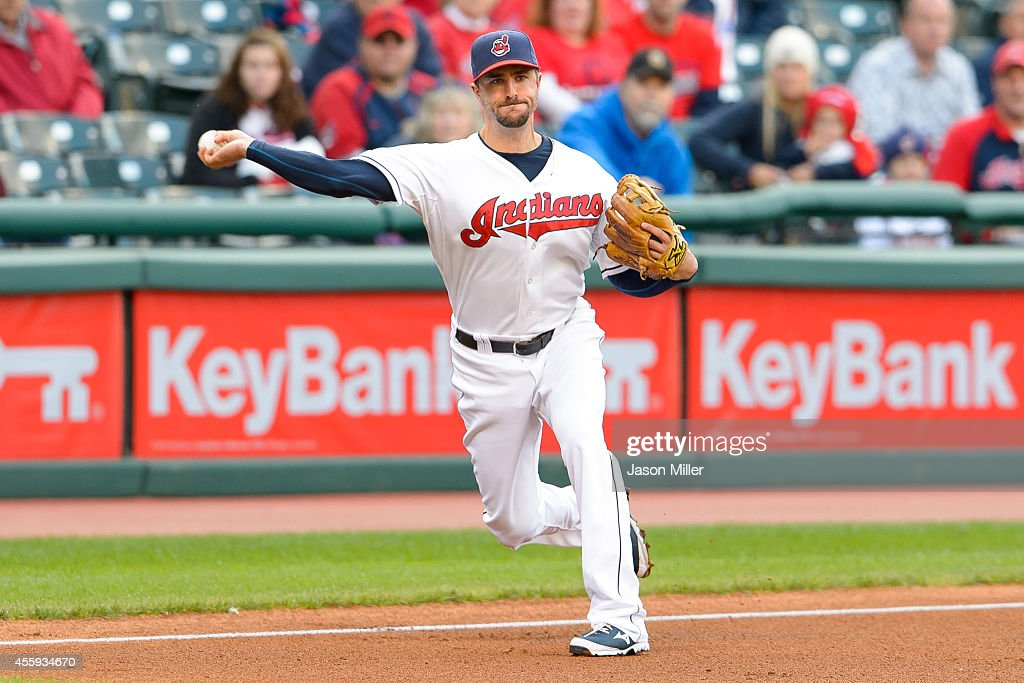 Third baseman Lonnie Chisenhall of the Cleveland Indians throws out Alcides Escobar of the Kansas City Royals at first during the resumed 10th inning...