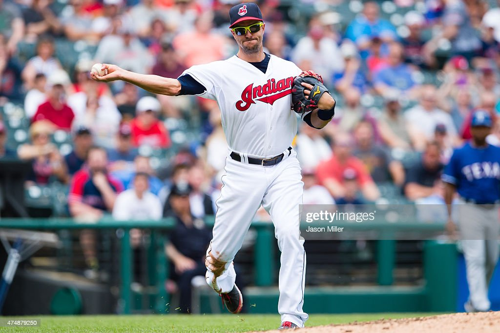 Third baseman Lonnie Chisenhall of the Cleveland Indians throws out Delino DeShields of the Texas Rangers at first on a sacrifice bunt during the...