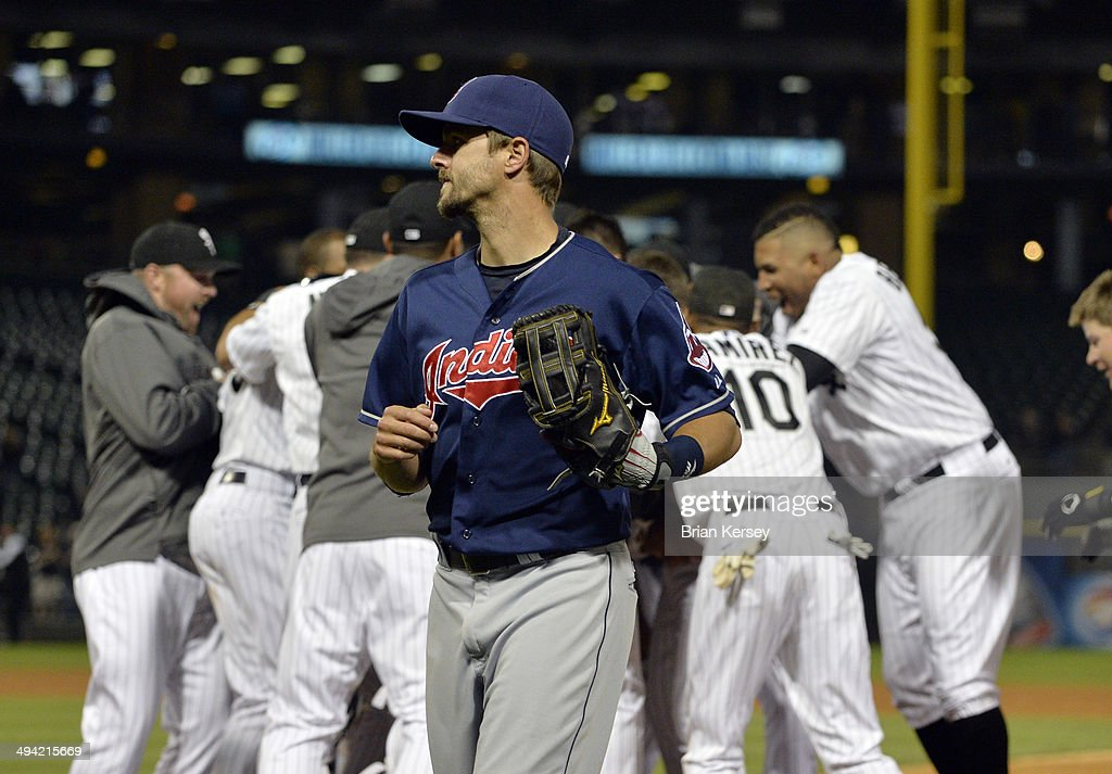 Third baseman Lonnie Chisenhall #8 of the Cleveland Indians trots off the field as the Chicago White Sox celebrate Moises Sierra's game-winning RBI single during the ninth inning at U.S. Cellular Field on May 28, 2014 in Chicago, Illinois. The White Sox defeated the Indians 3-2.