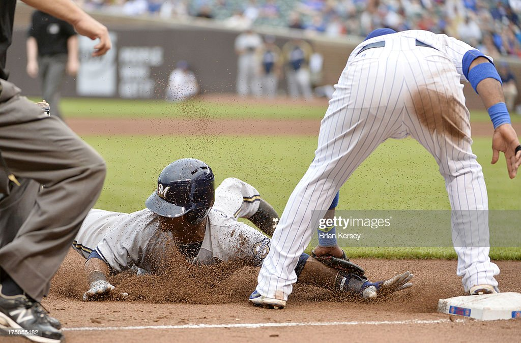 Third baseman <a gi-track='captionPersonalityLinkClicked' href=/galleries/search?phrase=Luis+Valbuena&family=editorial&specificpeople=5537111 ng-click='$event.stopPropagation()'>Luis Valbuena</a> #24 of the Chicago Cubs (R) tags out <a gi-track='captionPersonalityLinkClicked' href=/galleries/search?phrase=Jean+Segura&family=editorial&specificpeople=7521808 ng-click='$event.stopPropagation()'>Jean Segura</a> #9 of the Milwaukee Brewers as he tries to steal second base during the seventh inning at Wrigley Field on July 30, 2013 in Chicago, Illinois.
