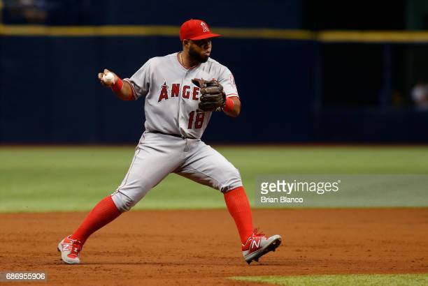 Third baseman Luis Valbuena of the Los Angeles Angels looks to throw after fielding the ground out by Evan Longoria of the Tampa Bay Rays during the...