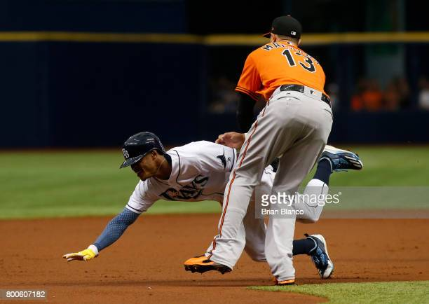 Third baseman Manny Machado of the Baltimore Orioles gets the out at third base on Mallex Smith of the Tampa Bay Rays on the run down to end the...