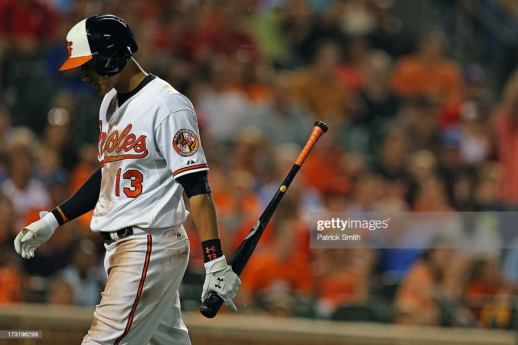Third baseman <a gi-track='captionPersonalityLinkClicked' href=/galleries/search?phrase=Manny+Machado&family=editorial&specificpeople=5591039 ng-click='$event.stopPropagation()'>Manny Machado</a> #13 of the Baltimore Orioles reacts after striking out against the Texas Rangers in the seventh inning at Oriole Park at Camden Yards on July 9, 2013 in Baltimore, Maryland. The Texas Rangers won, 8-4.