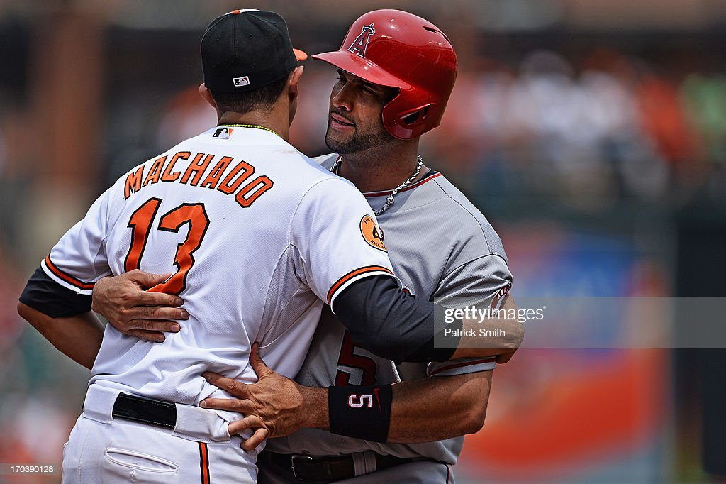 Third baseman <a gi-track='captionPersonalityLinkClicked' href=/galleries/search?phrase=Manny+Machado&family=editorial&specificpeople=5591039 ng-click='$event.stopPropagation()'>Manny Machado</a> #13 of the Baltimore Orioles tags out <a gi-track='captionPersonalityLinkClicked' href=/galleries/search?phrase=Albert+Pujols&family=editorial&specificpeople=171151 ng-click='$event.stopPropagation()'>Albert Pujols</a> #5 of the Los Angeles Angels of Anaheim in the sixth inning at Oriole Park at Camden Yards on June 12, 2013 in Baltimore, Maryland. The Los Angeles Angels of Anaheim won, 9-5.