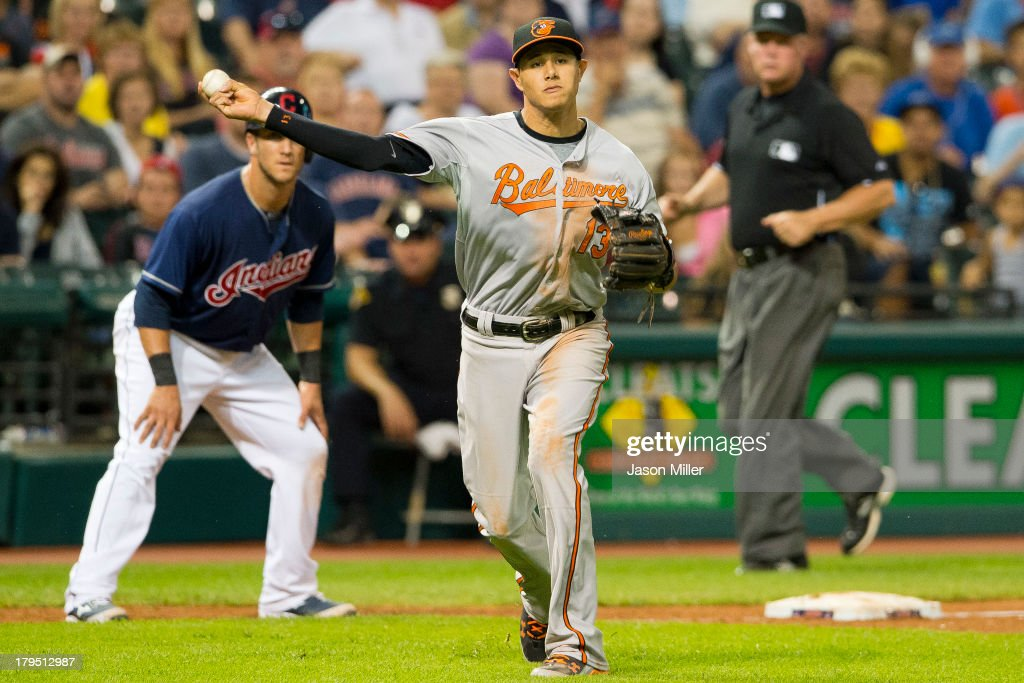 Third baseman <a gi-track='captionPersonalityLinkClicked' href=/galleries/search?phrase=Manny+Machado&family=editorial&specificpeople=5591039 ng-click='$event.stopPropagation()'>Manny Machado</a> #13 of the Baltimore Orioles throws out Ryan Raburn #9 of the Cleveland Indians during the fifth inning at Progressive Field on September 4, 2013 in Cleveland, Ohio.