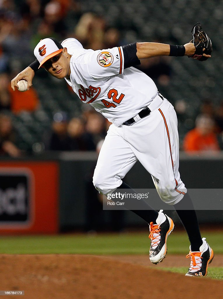 Third baseman <a gi-track='captionPersonalityLinkClicked' href=/galleries/search?phrase=Manny+Machado&family=editorial&specificpeople=5591039 ng-click='$event.stopPropagation()'>Manny Machado</a> #13 of the Baltimore Orioles throws to first base for the second out of the ninth inning against the Tampa Bay Rays during their 5-4 win at Oriole Park at Camden Yards on April 16, 2013 in Baltimore, Maryland.