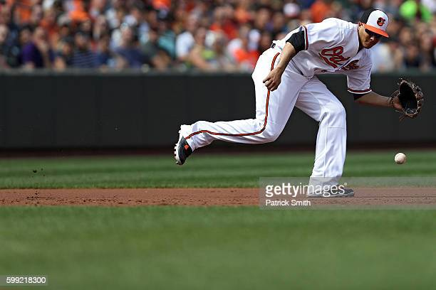 Third baseman Manny Machado of the Baltimore Orioles tries to make a play on a hit by Chase Headley of the New York Yankees during the third inning...