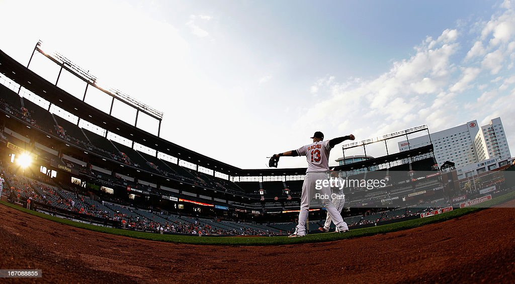 Third baseman <a gi-track='captionPersonalityLinkClicked' href=/galleries/search?phrase=Manny+Machado&family=editorial&specificpeople=5591039 ng-click='$event.stopPropagation()'>Manny Machado</a> #13 of the Baltimore Orioles warms up before the start of the Orioles game against the Tampa Bay Rays at Oriole Park at Camden Yards on April 18, 2013 in Baltimore, Maryland.