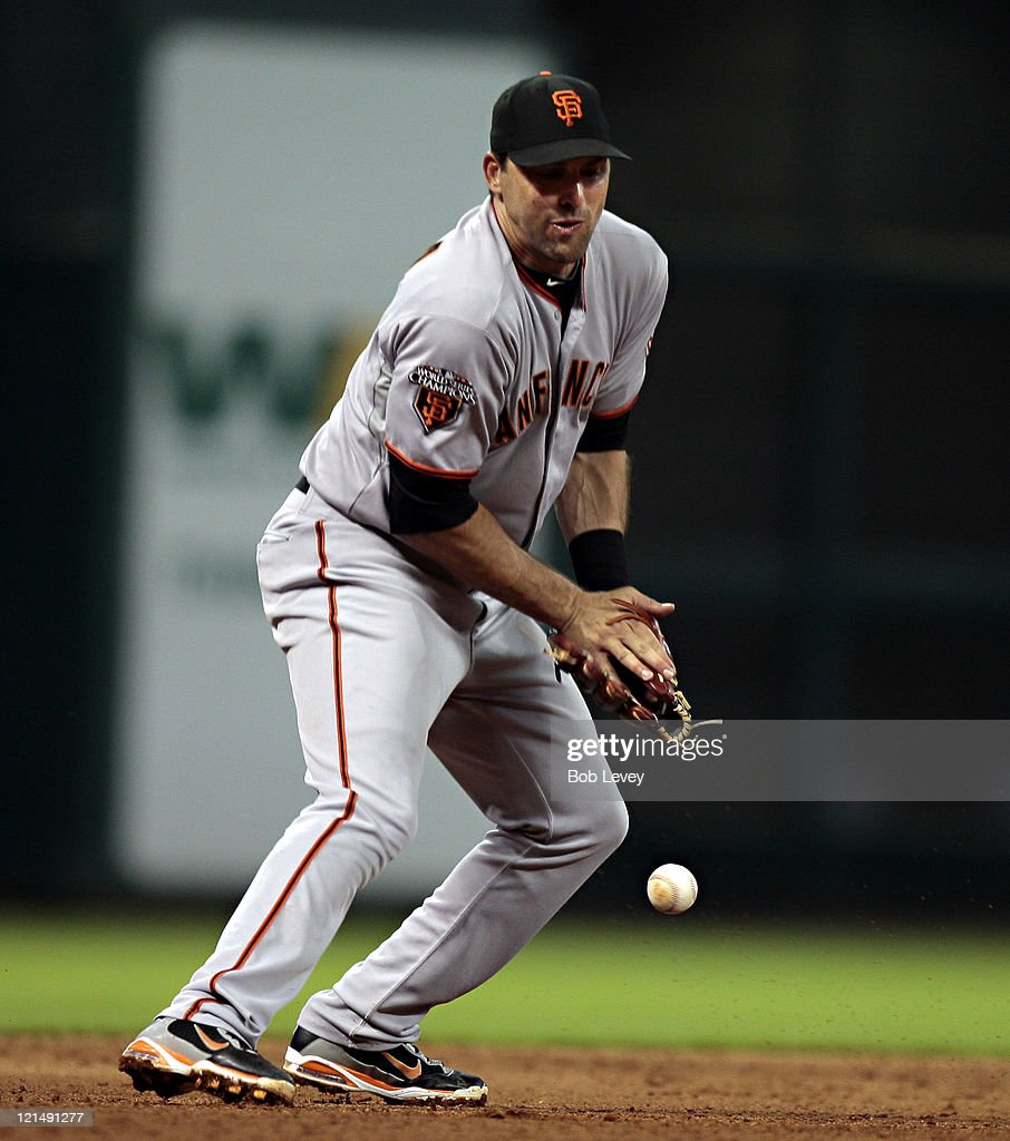 Third baseman <a gi-track='captionPersonalityLinkClicked' href=/galleries/search?phrase=Mark+DeRosa&family=editorial&specificpeople=228401 ng-click='$event.stopPropagation()'>Mark DeRosa</a> #7 of the San Francisco Giants can't handle a hard hit ball by Brian Bogusevic #19 of the Houston Astros in the sixth inning at Minute Maid Park on August 19, 2011 in Houston, Texas.