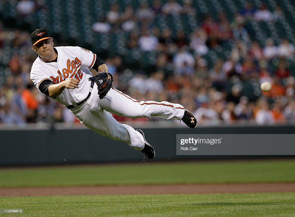 Third baseman <a gi-track='captionPersonalityLinkClicked' href=/galleries/search?phrase=Mark+Reynolds+-+Baseball+Player&family=editorial&specificpeople=2343799 ng-click='$event.stopPropagation()'>Mark Reynolds</a> #12 of the Baltimore Orioles throws out Dustin Pedroia #15 of the Boston Red Sox (not pictured) at first base during the third inning at Oriole Park at Camden Yards on April 28, 2011 in Baltimore, Maryland.