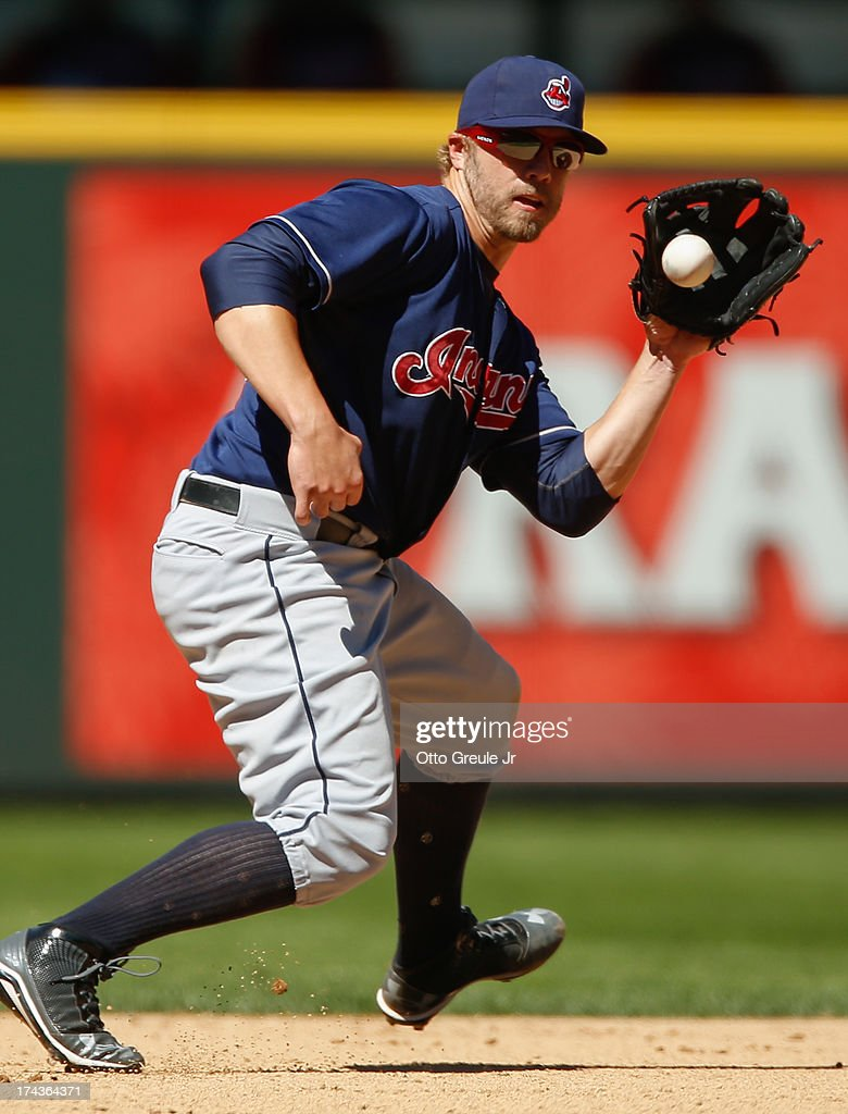 Third baseman <a gi-track='captionPersonalityLinkClicked' href=/galleries/search?phrase=Mark+Reynolds+-+Baseball+Player&family=editorial&specificpeople=2343799 ng-click='$event.stopPropagation()'>Mark Reynolds</a> #12 of the Cleveland Indians fields a grounder by Endy Chavez of the Seattle Mariners in the eighth inning at Safeco Field on July 24, 2013 in Seattle, Washington. Cleveland defeated the Mariners 10-1.