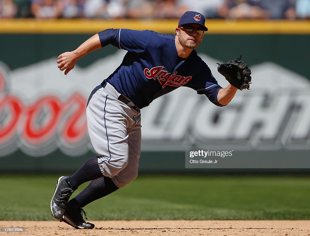Third baseman <a gi-track='captionPersonalityLinkClicked' href=/galleries/search?phrase=Mark+Reynolds+-+Baseball+Player&family=editorial&specificpeople=2343799 ng-click='$event.stopPropagation()'>Mark Reynolds</a> #12 of the Cleveland Indians reacts to a ground ball against the Seattle Mariners at Safeco Field on July 24, 2013 in Seattle, Washington.