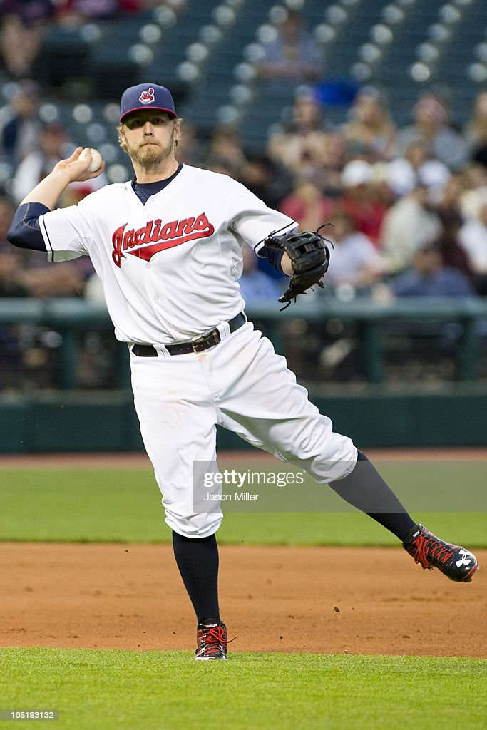 Third baseman <a gi-track='captionPersonalityLinkClicked' href=/galleries/search?phrase=Mark+Reynolds&family=editorial&specificpeople=2343799 ng-click='$event.stopPropagation()'>Mark Reynolds</a> #12 of the Cleveland Indians throws out Derek Norris #36 of the Oakland Athletics during the fifth inning at Progressive Field on May 6, 2013 in Cleveland, Ohio.