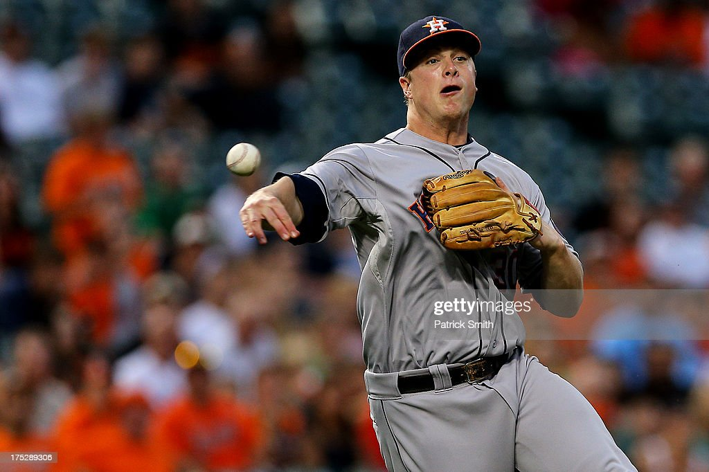 Third baseman <a gi-track='captionPersonalityLinkClicked' href=/galleries/search?phrase=Matt+Dominguez&family=editorial&specificpeople=2934044 ng-click='$event.stopPropagation()'>Matt Dominguez</a> #30 of the Houston Astros throws out J.J. Hardy #2 of the Baltimore Orioles (not pictured) in the second inning at Oriole Park at Camden Yards on August 1, 2013 in Baltimore, Maryland. The Baltimore Orioles won, 6-3.