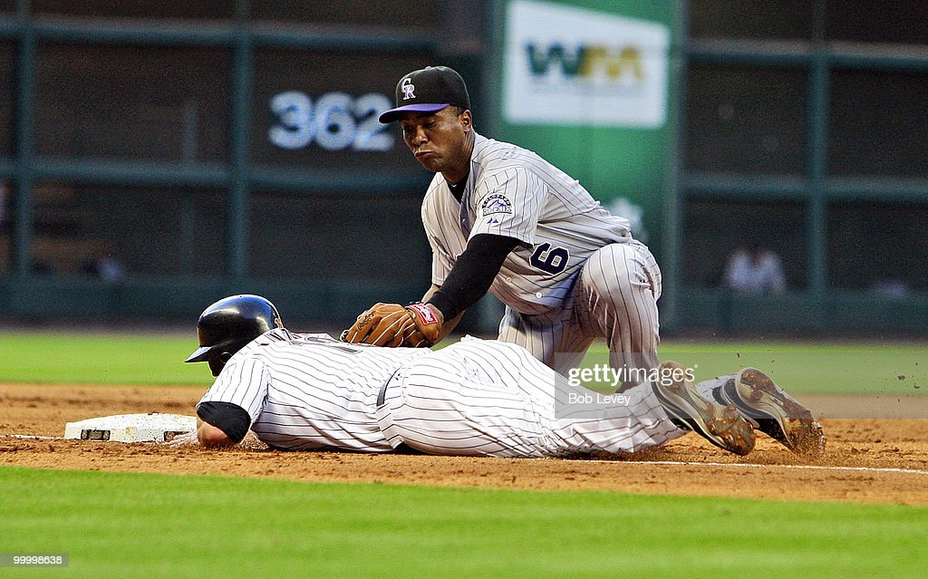 Third baseman Melvin Mora #6 of the Colorado Rockies tags out Tommy Manzella of the Houston Astros as he was picked off by catcher Miguel Olivo in the second inning at Minute Maid Park> on May 19, 2010 in Houston, Texas.