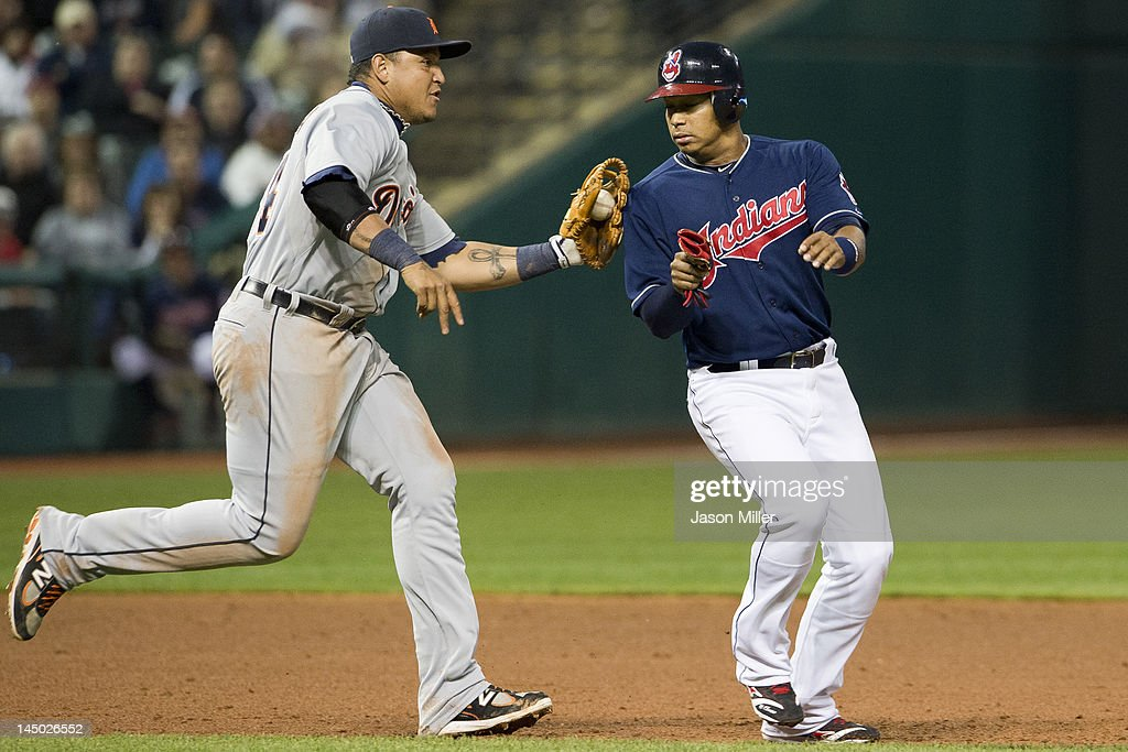 Third baseman <a gi-track='captionPersonalityLinkClicked' href=/galleries/search?phrase=Miguel+Cabrera&family=editorial&specificpeople=202141 ng-click='$event.stopPropagation()'>Miguel Cabrera</a> #24 of the Detroit Tigers tags out <a gi-track='captionPersonalityLinkClicked' href=/galleries/search?phrase=Jose+Lopez&family=editorial&specificpeople=239051 ng-click='$event.stopPropagation()'>Jose Lopez</a> #4 of the Cleveland Indians in a run down during the sixth inning at Progressive Field on May 22, 2012 in Cleveland, Ohio.