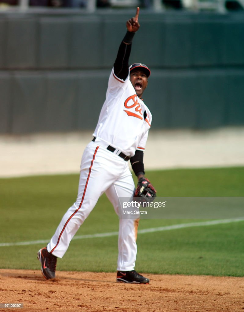 Third baseman <a gi-track='captionPersonalityLinkClicked' href=/galleries/search?phrase=Miguel+Tejada&family=editorial&specificpeople=202227 ng-click='$event.stopPropagation()'>Miguel Tejada</a> #9 of the Baltimore Orioles calls a play against the Tampa Bay Rays at Ed Smith Stadium on March 3, 2010 in Sarasota, Florida.