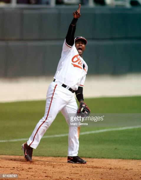 Third baseman Miguel Tejada of the Baltimore Orioles calls a play against the Tampa Bay Rays at Ed Smith Stadium on March 3 2010 in Sarasota Florida