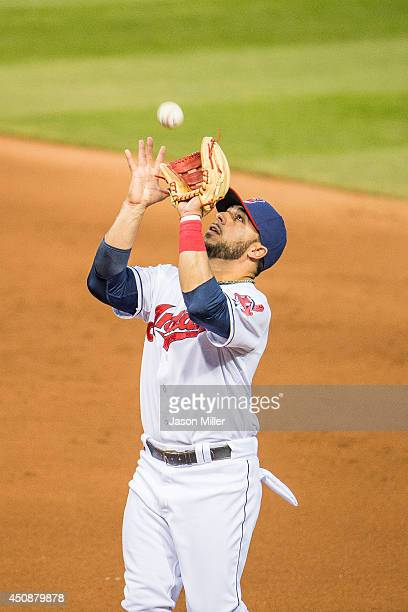 Third baseman Mike Aviles of the Cleveland Indians catches a pop up hit by Ian Kinsler of the Detroit Tigers in the fourth inning during the game...