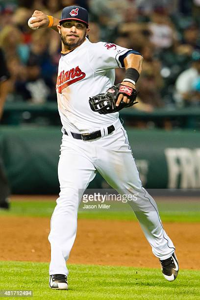Third baseman Mike Aviles of the Cleveland Indians throws out Adam Eaton of the Chicago White Sox at first during the ninth inning at Progressive...