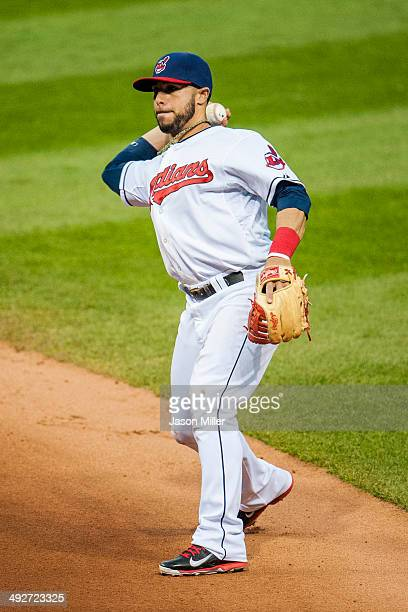 Third baseman Mike Aviles of the Cleveland Indians throws out Pedro Florimon of the Minnesota Twins at first during the fifth inning at Progressive...