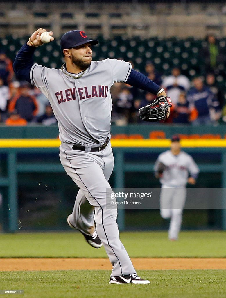 Third baseman <a gi-track='captionPersonalityLinkClicked' href=/galleries/search?phrase=Mike+Aviles&family=editorial&specificpeople=4944765 ng-click='$event.stopPropagation()'>Mike Aviles</a> #4 of the Cleveland Indians throws to first base to make the last out of the game on Miguel Cabrera of the Detroit Tigers at Comerica Park on May 11, 2013 in Detroit, Michigan.