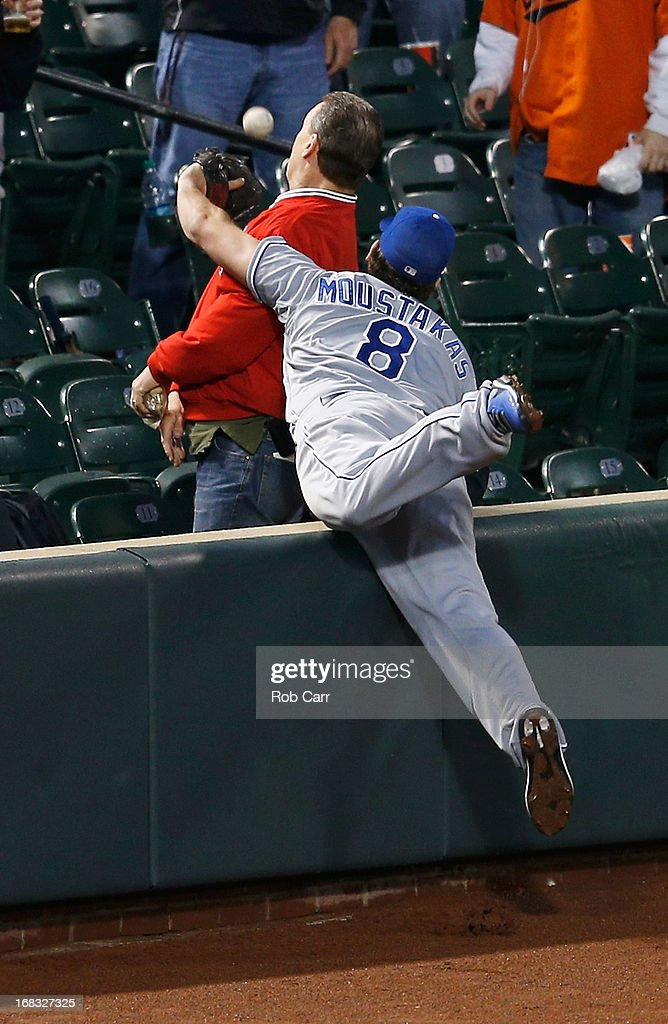 Third baseman <a gi-track='captionPersonalityLinkClicked' href=/galleries/search?phrase=Mike+Moustakas&family=editorial&specificpeople=6780077 ng-click='$event.stopPropagation()'>Mike Moustakas</a> #8 of the Kansas City Royals misses a foul ball hit by Nate McLouth #9 of the Baltimore Orioles (not pictured) during the fifth inning at Oriole Park at Camden Yards on May 8, 2013 in Baltimore, Maryland.