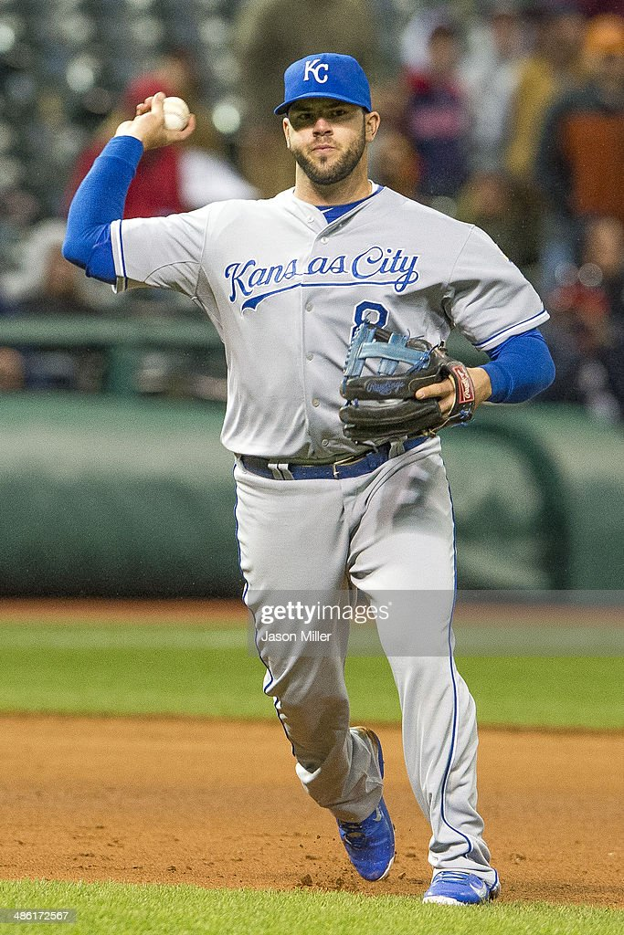 Third baseman <a gi-track='captionPersonalityLinkClicked' href=/galleries/search?phrase=Mike+Moustakas&family=editorial&specificpeople=6780077 ng-click='$event.stopPropagation()'>Mike Moustakas</a> #8 of the Kansas City Royals throws out Carlos Santana #41 of the Cleveland Indians at first to end the seventh inning at Progressive Field on April 22, 2014 in Cleveland, Ohio.