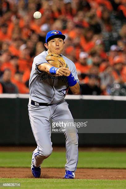 Third baseman Munenori Kawasaki of the Toronto Blue Jays throws a Baltimore Orioles batter out at first base during the second inning at Oriole Park...