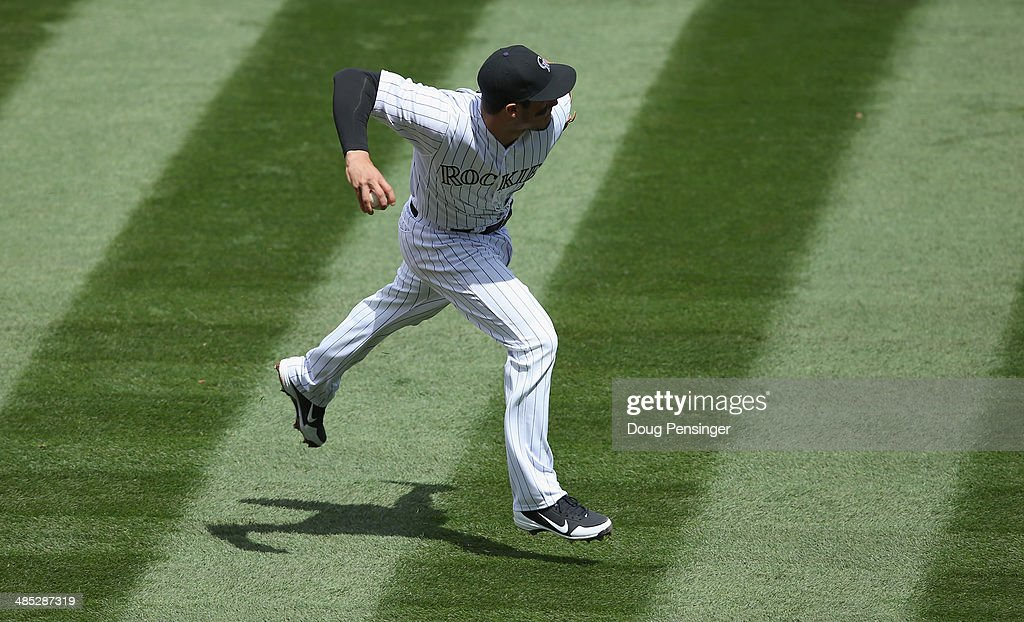 Third baseman <a gi-track='captionPersonalityLinkClicked' href=/galleries/search?phrase=Nolan+Arenado&family=editorial&specificpeople=7934273 ng-click='$event.stopPropagation()'>Nolan Arenado</a> #28 of the Colorado Rockies bare hands a ground ball and throws out a runner against the Chicago White Sox during Interleague play at Coors Field on April 9, 2014 in Denver, Colorado. The Rockies defeated the White Sox 10-4.