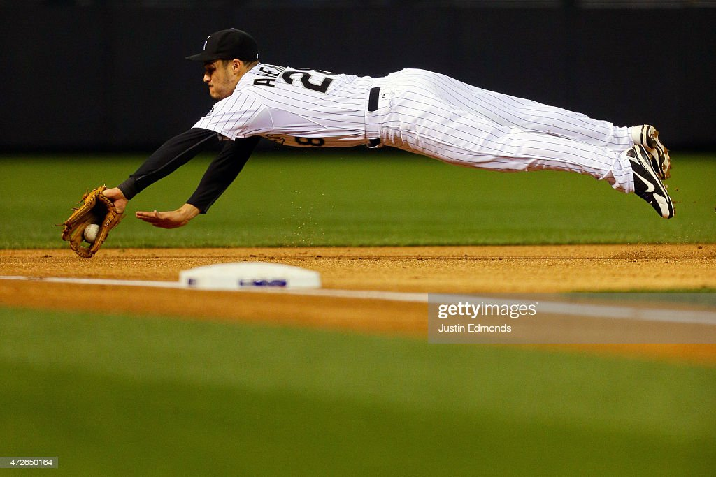 Third baseman Nolan Arenado of the Colorado Rockies dives on an infield hit by Alex Guerrero of the Los Angeles Dodgers during the first inning at...