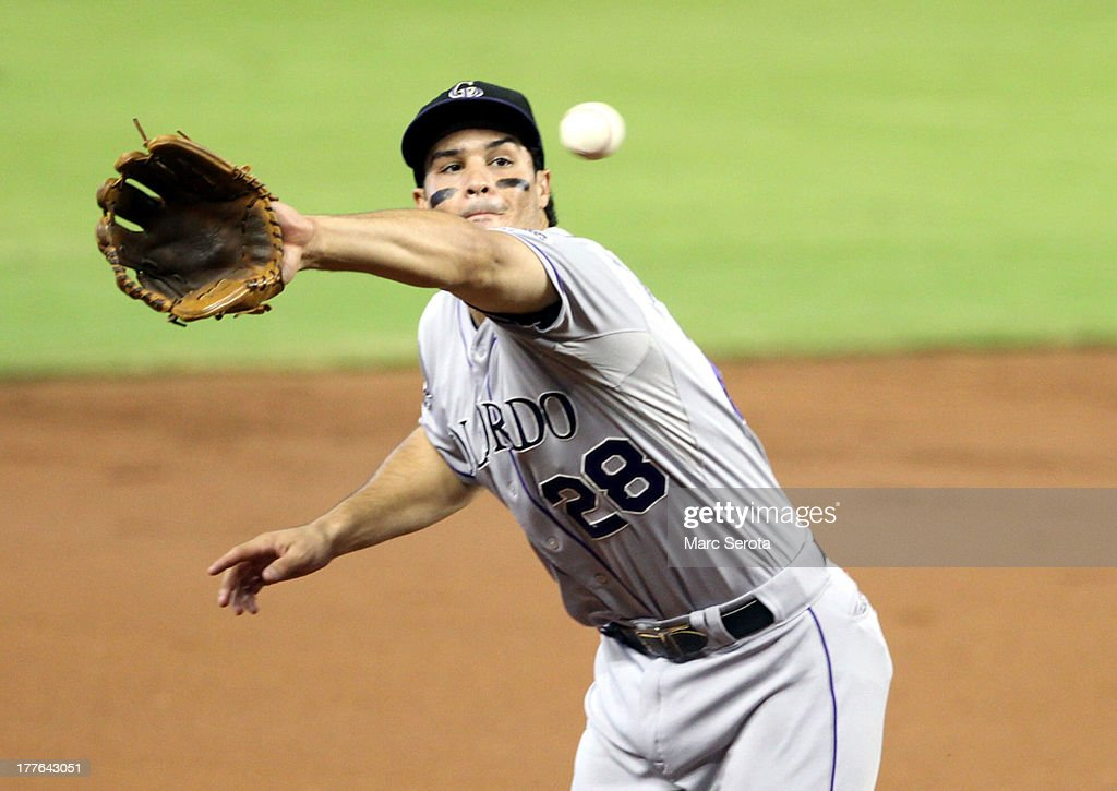 Third baseman <a gi-track='captionPersonalityLinkClicked' href=/galleries/search?phrase=Nolan+Arenado&family=editorial&specificpeople=7934273 ng-click='$event.stopPropagation()'>Nolan Arenado</a> #28 of the Colorado Rockies makes a backhanded catch against the Miami Marlins at Marlins Park on August 25, 2013 in Miami, Florida.