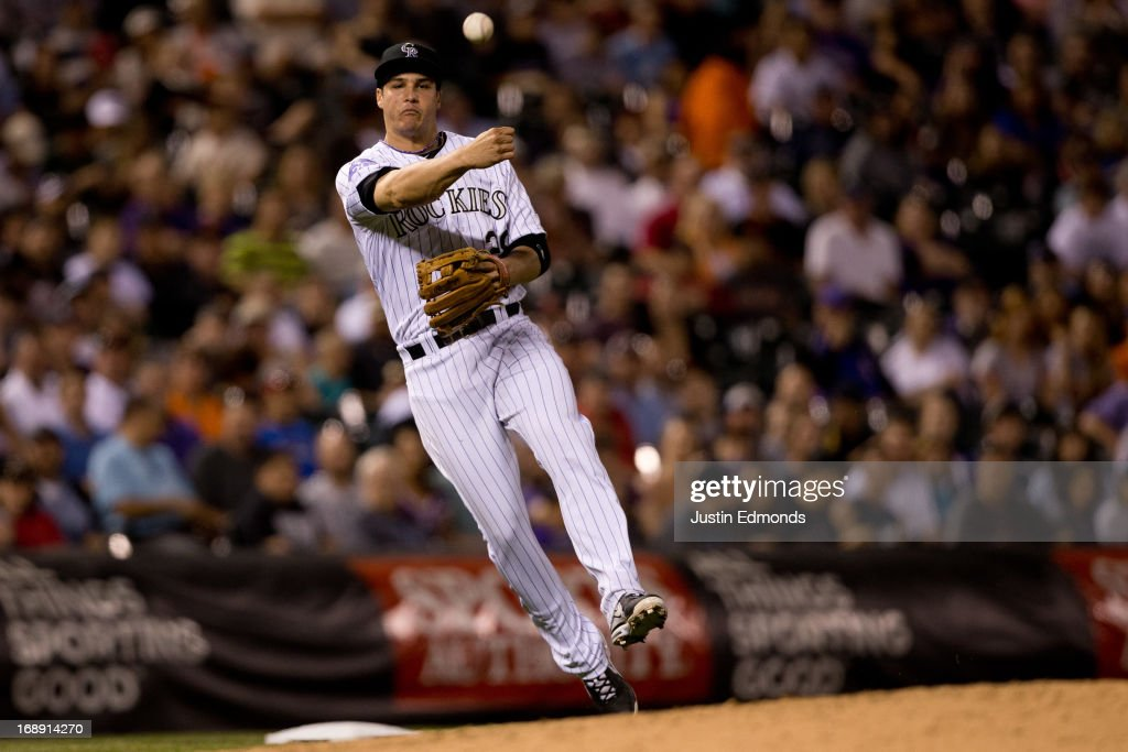 Third baseman <a gi-track='captionPersonalityLinkClicked' href=/galleries/search?phrase=Nolan+Arenado&family=editorial&specificpeople=7934273 ng-click='$event.stopPropagation()'>Nolan Arenado</a> #28 of the Colorado Rockies makes a throw on the run for the first out of the seventh inning against the San Francisco Giants at Coors Field on May 16, 2013 in Denver, Colorado. The Giants defeated the Rockies 8-6.