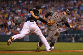 Third baseman Nolan Arenado of the Colorado Rockies tags out Phil Gosselin of the Arizona Diamondbacks on a fielder's choice for the first out of the...