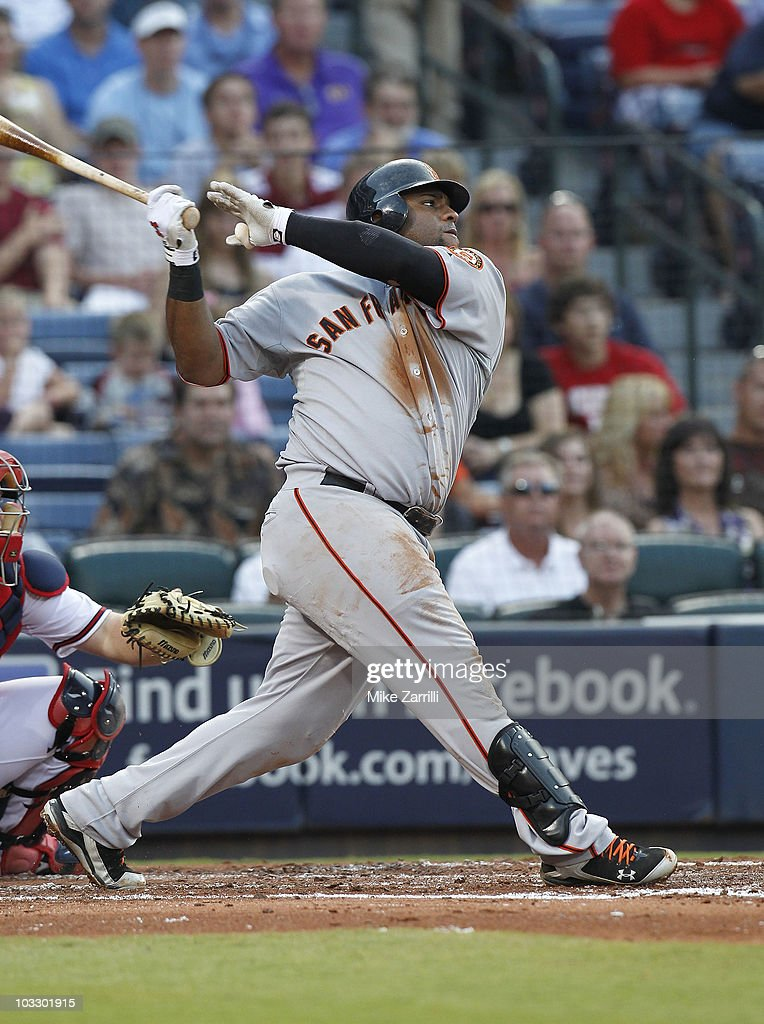 Third baseman <a gi-track='captionPersonalityLinkClicked' href=/galleries/search?phrase=Pablo+Sandoval&family=editorial&specificpeople=803207 ng-click='$event.stopPropagation()'>Pablo Sandoval</a> #48 of the San Francisco Giants follows through on a swing during the game against the Atlanta Braves at Turner Field on August 7, 2010 in Atlanta, Georgia. The Braves beat the Giants 3-0.