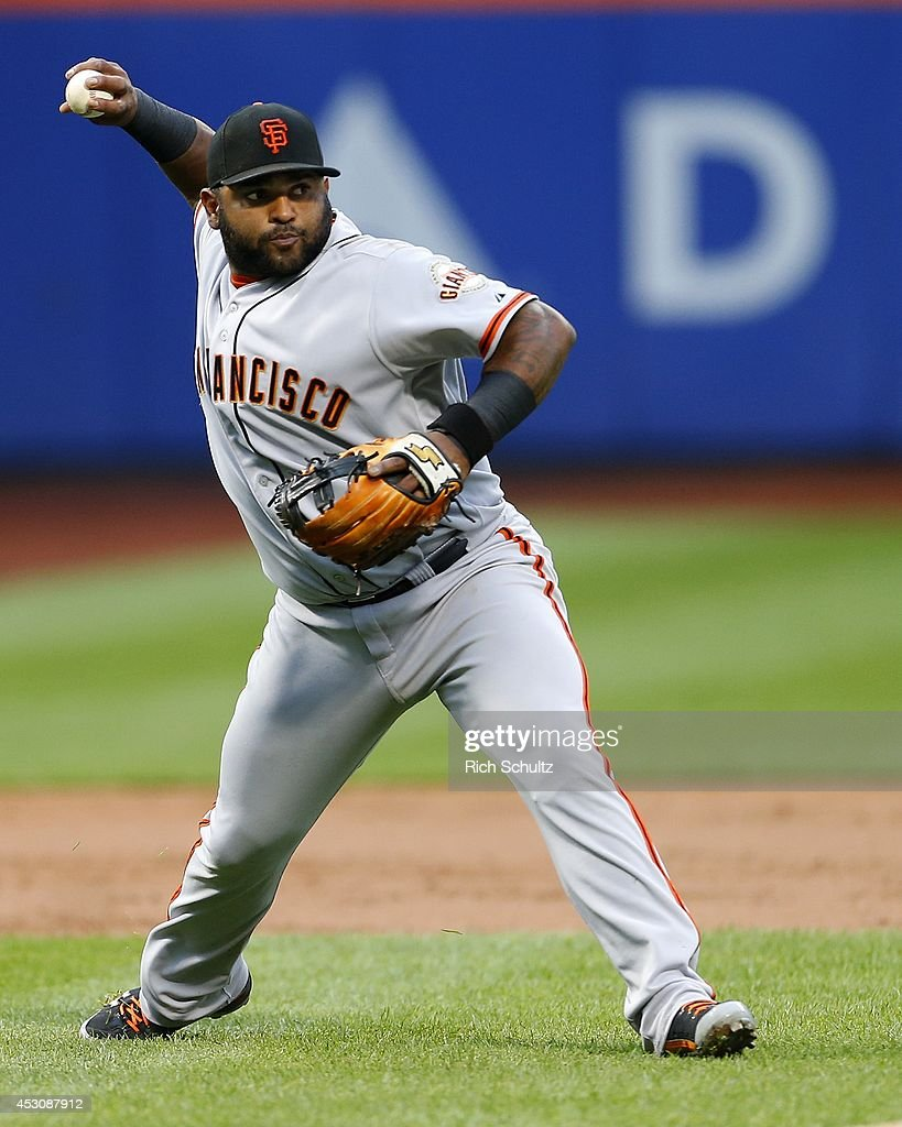 Third baseman <a gi-track='captionPersonalityLinkClicked' href=/galleries/search?phrase=Pablo+Sandoval&family=editorial&specificpeople=803207 ng-click='$event.stopPropagation()'>Pablo Sandoval</a> #48 of the San Francisco Giants makes a throw to first base to get Juan Lagares #12 of the New York Mets in the second inning on August 2, 2014 at Citi Field in the Flushing neighborhood of the Queens borough of New York City.
