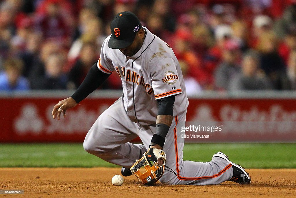 Third baseman Pablo Sandoval #48 of the San Francisco Giants misplays a groundball in the second inning as Pete Kozma #38 of the St. Louis Cardinals reaches safely on an error in Game Four of the National League Championship Series at Busch Stadium on October 18, 2012 in St Louis, Missouri.
