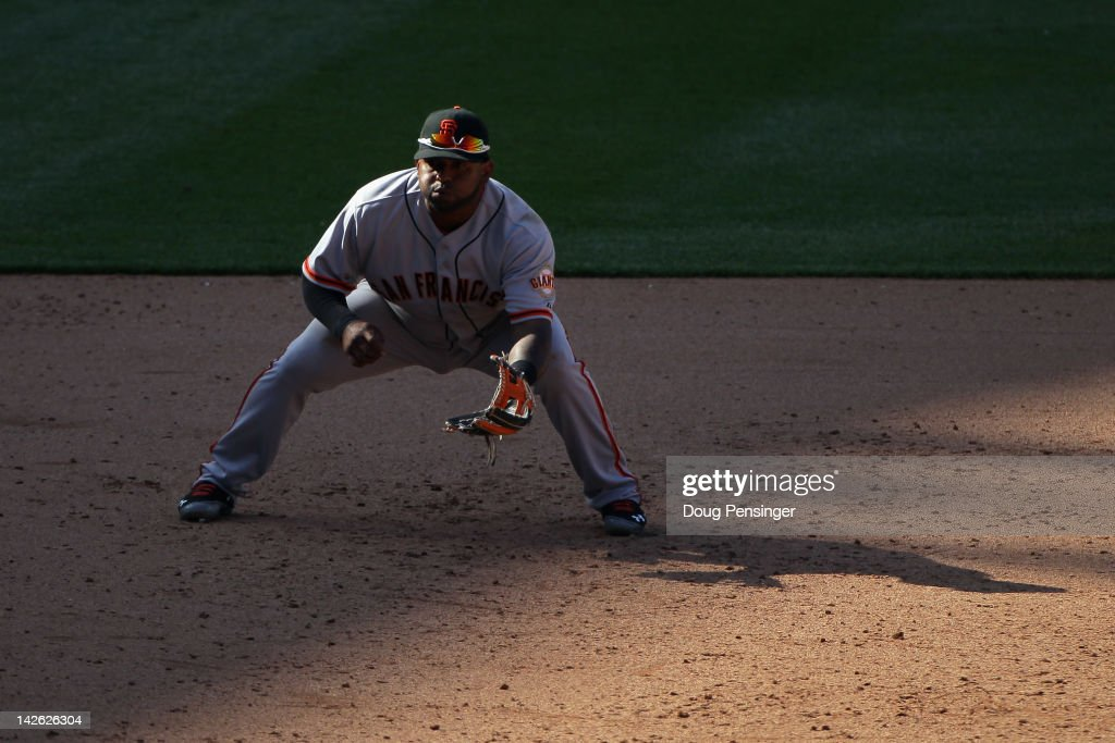 Third baseman <a gi-track='captionPersonalityLinkClicked' href=/galleries/search?phrase=Pablo+Sandoval&family=editorial&specificpeople=803207 ng-click='$event.stopPropagation()'>Pablo Sandoval</a> #48 of the San Francisco Giants plays defense against the Colorado Rockies on Opening Day at Coors Field on April 9, 2012 in Denver, Colorado. The Giants defeated the Rockies 7-0.