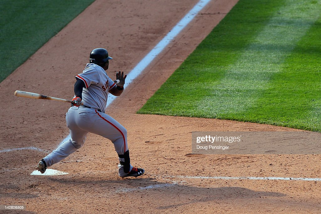 Third baseman <a gi-track='captionPersonalityLinkClicked' href=/galleries/search?phrase=Pablo+Sandoval&family=editorial&specificpeople=803207 ng-click='$event.stopPropagation()'>Pablo Sandoval</a> #48 of the San Francisco Giants takes an at bat against the Colorado Rockies on Opening Day at Coors Field on April 9, 2012 in Denver, Colorado. The Giants defeated the Rockies 7-0.