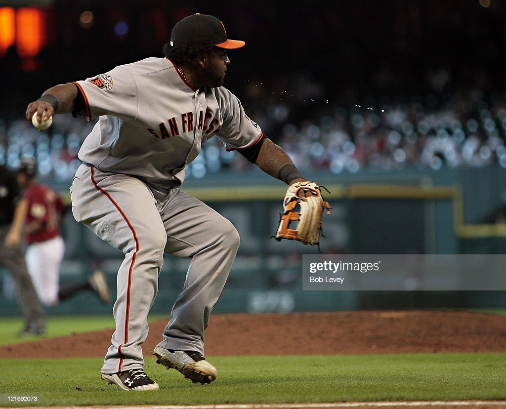 Third baseman <a gi-track='captionPersonalityLinkClicked' href=/galleries/search?phrase=Pablo+Sandoval&family=editorial&specificpeople=803207 ng-click='$event.stopPropagation()'>Pablo Sandoval</a> #48 of the San Francisco Giants throws out Jose Altuve #27 of the Houston Astros after a sacrifice bunt inthe ninth inning at Minute Maid Park on August 21, 2011 in Houston, Texas.