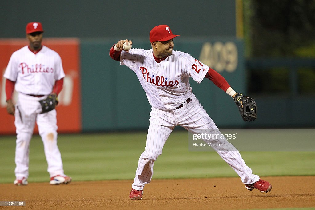 Third baseman <a gi-track='captionPersonalityLinkClicked' href=/galleries/search?phrase=Placido+Polanco&family=editorial&specificpeople=213170 ng-click='$event.stopPropagation()'>Placido Polanco</a> #27 of the Philadelphia Phillies throws to first base during a game against the Chicago Cubs at Citizens Bank Park on April 28, 2012 in Philadelphia, Pennsylvania. The Phillies won 5-2.