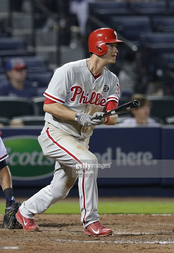 Third baseman <a gi-track='captionPersonalityLinkClicked' href=/galleries/search?phrase=Reid+Brignac&family=editorial&specificpeople=4175431 ng-click='$event.stopPropagation()'>Reid Brignac</a> #17 of the Philadelphia Phillies connects for a 2-run RBI triple in the 13th inning during the game against the Atlanta Braves at Turner Field on June 16, 2014 in Atlanta, Georgia.
