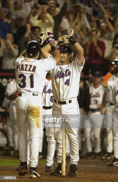 Third baseman Robin Ventura of the New York Mets congratulates catcher Mike Piazza after Piazza hit a 2run home run in the eighth inning of the MLB...