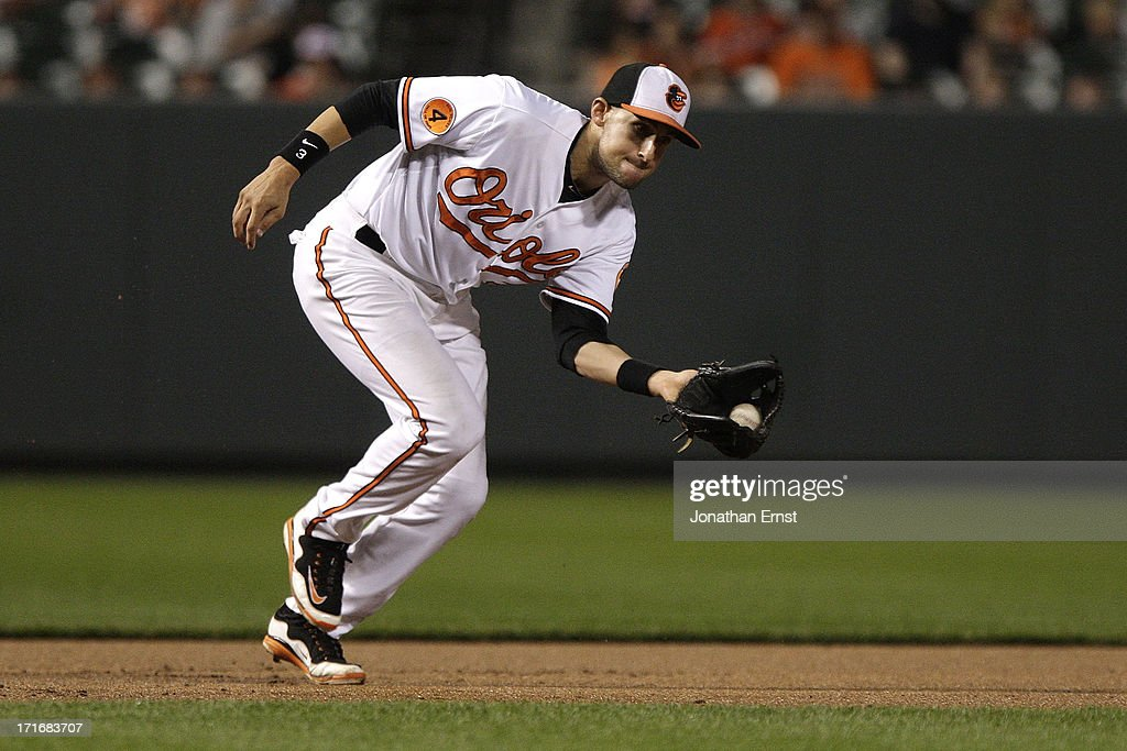 Third baseman <a gi-track='captionPersonalityLinkClicked' href=/galleries/search?phrase=Ryan+Flaherty&family=editorial&specificpeople=4412528 ng-click='$event.stopPropagation()'>Ryan Flaherty</a> #3 of the Baltimore Orioles collects a ground ball by Carlos Santana #41 of the Cleveland Indians and completed the put out during the eighth inning at Oriole Park at Camden Yards on June 27, 2013 in Baltimore, Maryland. The Baltimore Orioles won, 7-3.