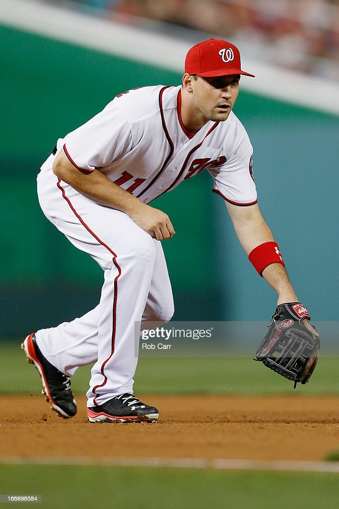 Third baseman <a gi-track='captionPersonalityLinkClicked' href=/galleries/search?phrase=Ryan+Zimmerman+-+Baseball+Player&family=editorial&specificpeople=534809 ng-click='$event.stopPropagation()'>Ryan Zimmerman</a> #11 of the Washington Nationals follows a pitch against the Atlanta Braves at Nationals Park on April 12, 2013 in Washington, DC.