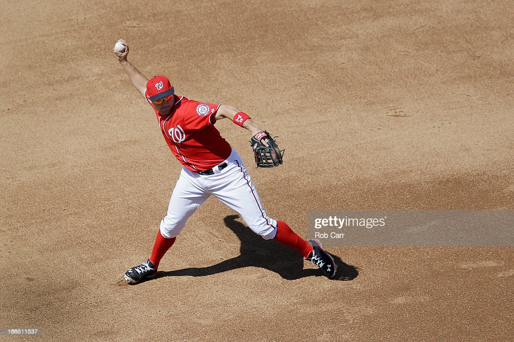 Third baseman <a gi-track='captionPersonalityLinkClicked' href=/galleries/search?phrase=Ryan+Zimmerman+-+Baseball+Player&family=editorial&specificpeople=534809 ng-click='$event.stopPropagation()'>Ryan Zimmerman</a> #11 of the Washington Nationals throws to first base during the seventh inning against the Atlanta Braves at Nationals Park on April 13, 2013 in Washington, DC.