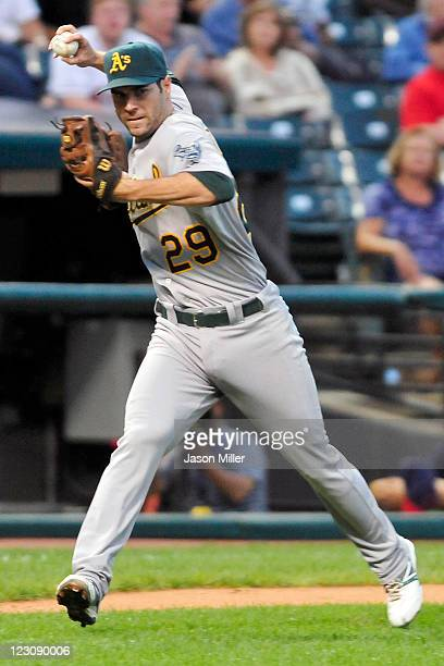 Third baseman Scott Sizemore of the Oakland Athletics throws out Jason Donald of the Cleveland Indians who hit aground ball during the third inning...