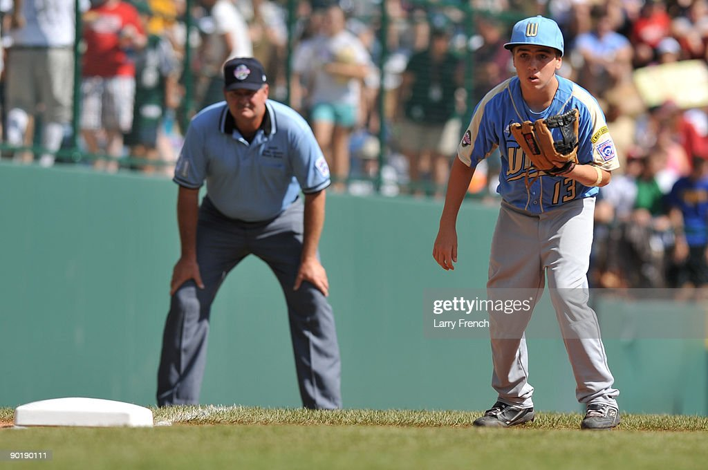 Third baseman Seth Godfrey #13 of California (Chula Vista) anticipates a play during the game against Asia Pacific (Taoyuan, Taiwan) in the little league world series final at Lamade Stadium on August 30, 2009 in Williamsport, Pennsylvania.