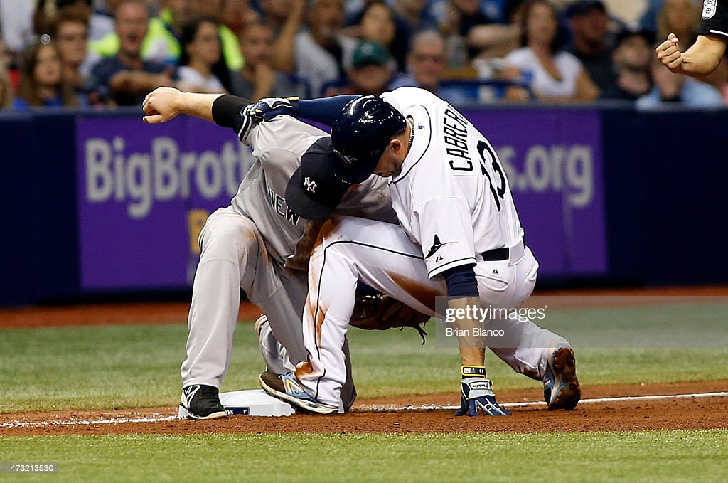 Third baseman Stephen Drew #14 of the New York Yankees catches Asdrubal Cabrera #13 of the Tampa Bay Rays attempting to steal third base during the fourth inning of a game on May 13, 2015 at Tropicana Field in St. Petersburg, Florida.